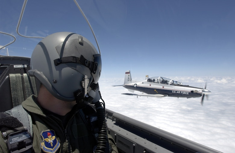 A T-6A Texan II pilot flies in formation with another T-6A over Laughlin Air Force Base, Texas.