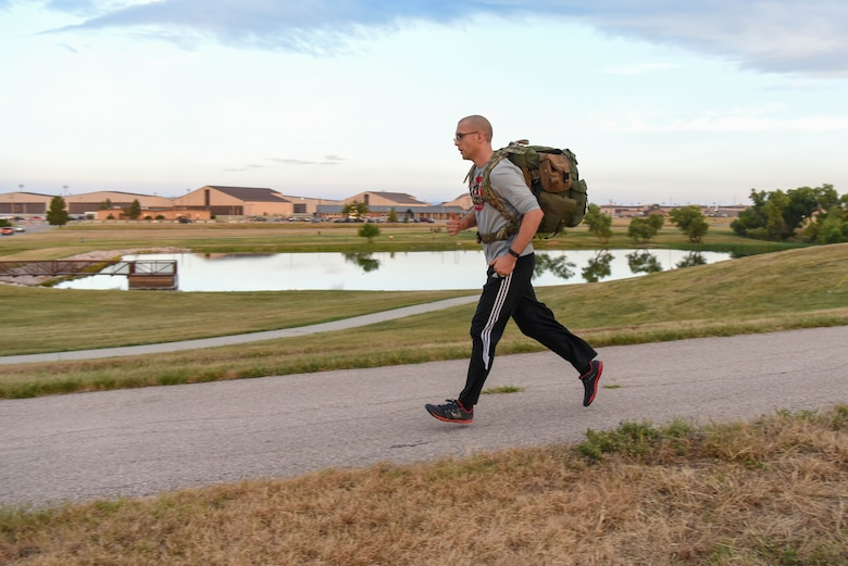 A service member participates in a Patriot Day 5K ruck march at Ellsworth Air Force Base, S.D., Sept. 11, 2018. Members of the 28th Force Support Squadron organized the event in remembrance of the nearly 3,000 people that died as result of the 9/11 terrorist attack. (U.S. Air Force photo by Airman Christina Bennett)