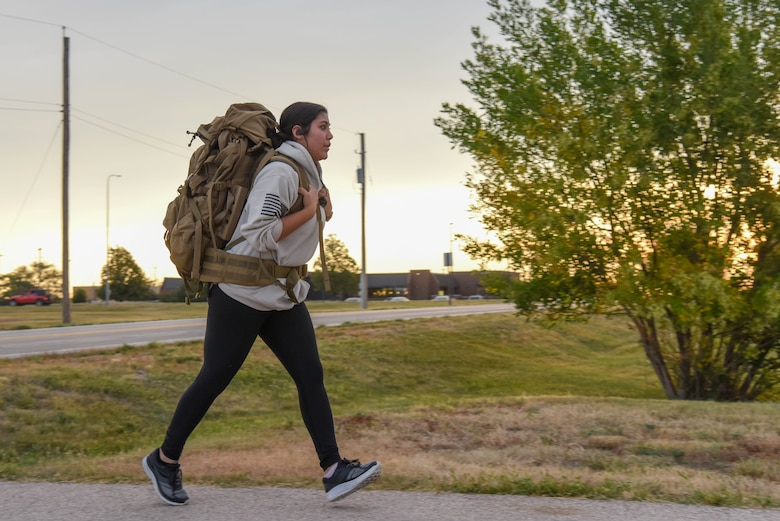A 5K participant runs with a weighted rucksack in honor of Patriot Day at Ellsworth Air Force Base, S.D., Sept. 11, 2018.  The day marked the 17th anniversary of the 9/11 terrorist attack that claimed the lives of approximately 3,000 people and injured thousands of others. (U.S. Air Force photo by Airman Christina Bennett)