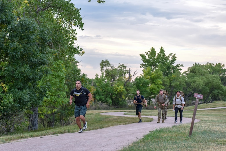 Service members participate in a 5K ruck march held in honor of Patriot Day at Ellsworth Air Force Base, S.D., Sept. 11, 2018. Approximately 35 men and women came together to ruck march on the 17th anniversary of the 9/11 terrorist attack that claimed the lives of nearly 3,000 people. (U.S. Air Force photo by Airman Christina Bennett)