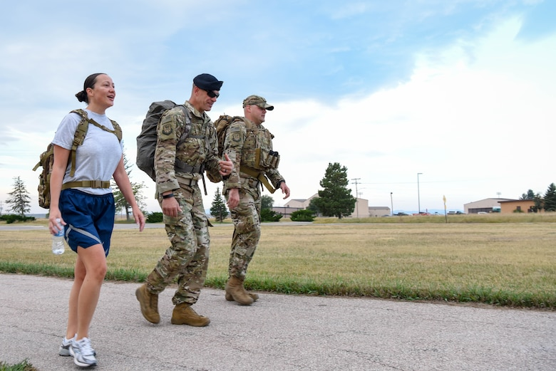 Service members participate in a 5K ruck march held in honor of Patriot Day at Ellsworth Air Force Base, S.D., Sept. 11, 2018. Participants gathered at the Heritage Lake pavilion on base prior to the ruck march to observe a moment of silence in remembrance of those who died as result of the 9/11 terrorist attack. (U.S. Air Force photo by Airman Christina Bennett)