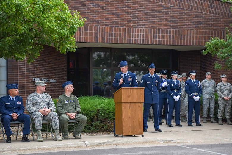 Senior Master Sgt. Zachary Townsend, the 28th Civil Engineer Squadron deputy fire chief, addresses the audience during a 9/11 memorial ceremony outside of the 28th Bomb Wing headquarters at Ellsworth Air Force Base, S.D., Sept. 11, 2018. The memorial ceremony was organized by the 28th CES Fire Department in honor of the nearly 3,000 people that died on Sept. 11, 2001. (U.S. Air Force photo by Airman Christina Bennett)
