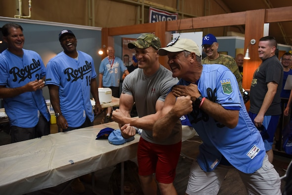 "George Brett, a Kansas City Royals baseball legend, flexes with a fan during the USO tour ""This one's for you"" Sept. 12, 2018, at Camp Buehring, Kuwait. Fans met with the legends and watched a live-stream Royals versus Chicago White Sox game. (U.S. Air Force photo by Tech. Sgt. Caleb Pierce)"