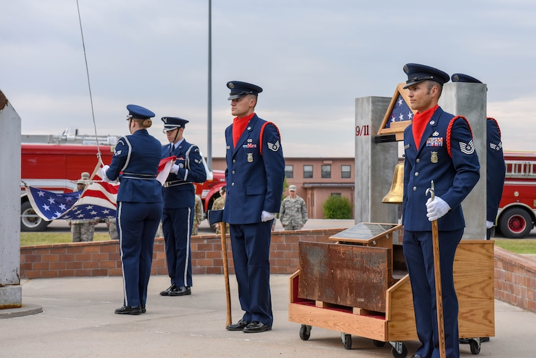 Members of the 28th Civil Engineer Squadron fire department rang the fire department bell at the 9/11 memorial ceremony outside of the 28th Bomb Wing headquarters at Ellsworth Air Force Base, S.D., Sept. 11, 2018. The bell was struck in three intervals of five rings, as firefighter tradition, in honor of the 343 firefighters that died on Sept. 11, 2001. (U.S. Air Force photo by Airman Christina Bennett)
