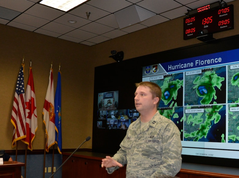 Capt. Leonard Mounsey, 601st Air Operations Center weather specialty team, describes the current forecast conditions related to Hurricane Florence during the Air Forces Northern morning commander's update briefing Sept. 14. From providing specialized job personnel and equipment to assigning staging areas for supplies, AFNORTH, the air component of U.S. Northern Command, continues to assist that command's support of the Federal Emergency Management Agency's Hurricane Florence relief efforts. (Air Force photo by Mary McHale)