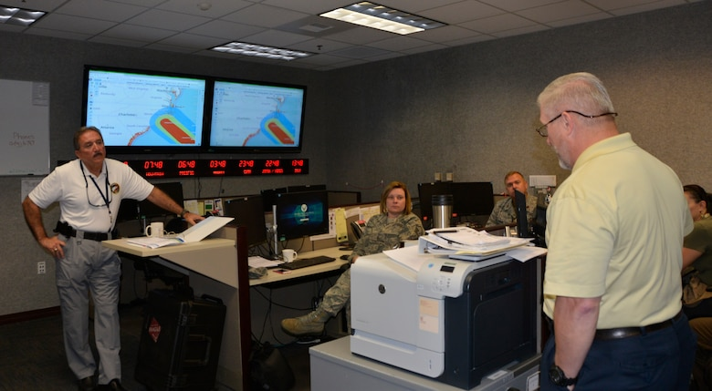 02.	Rodney Simmons, National Security Emergency Preparedness director, Air Forces Northern, listens as Joe Sanders, deputy NSEP director, briefs current Hurricane Florence conditions Sept. 11 in the NSEP operations cell. From providing specialized job personnel and equipment to assigning staging areas for supplies, AFNORTH, the air component of U.S. Northern Command, continues to assist that command's support of the Federal Emergency Management Agency's Hurricane Florence relief efforts. (Air Force photo by Mary McHale)