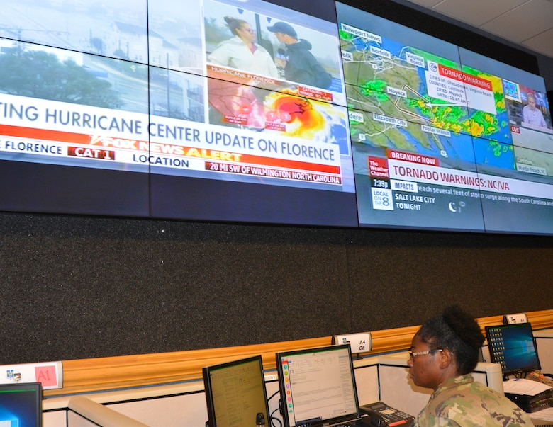 05.	U.S. Army MAJ. Latanya Matthews, Chemical, Biological, Radiological and Nuclear operations officer with the Air Forces Northern Logistics Directorate, reviews information about Hurricane Florence Sept. 14 in the Contingency Action Team room. From providing specialized job personnel and equipment to assigning staging areas for supplies, AFNORTH, the air component of U.S. Northern Command, continues to assist that command's support of the Federal Emergency Management Agency's Hurricane Florence relief efforts. (Air Force photo by Mary McHale)