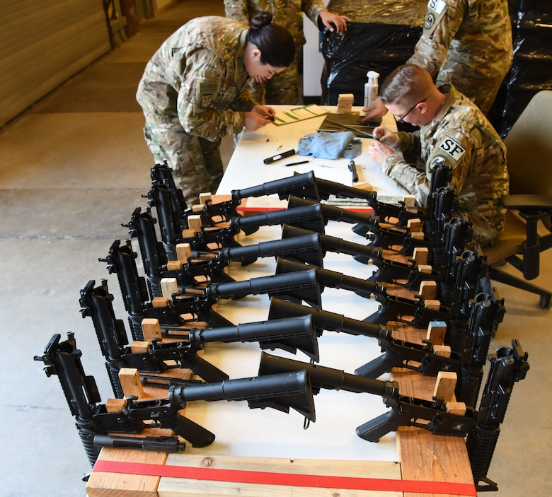 Members assigned to the 28th Security Forces Squadron combat arms training and maintenance flight, inspect M4 carbines at Ellsworth Air Force Base, S.D., Sept. 10, 2018. CATM conducted their biannual inspection of all weapons on base to ensure they are ready for use in a deployed environment and for training purposes. (U.S. Air Force photo by Airman 1st Class Thomas Karol)