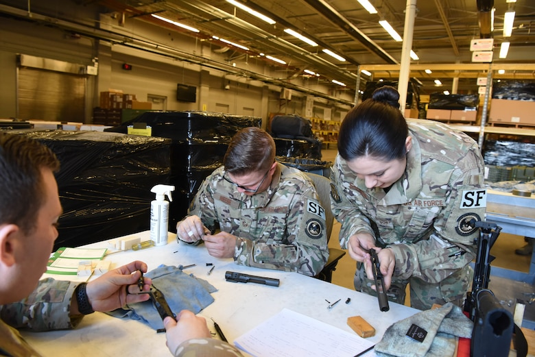 Staff Sgt. Elizabeth Gregson, a 28th Security Forces Squadron combat arms instructor, inspects an M4 bolt carrier at Ellsworth Air Force Base, S.D., Sept. 10, 2018. Members assigned to the 28th Security Forces Squadron combat arms training and maintenance flight conducted their biannual inspection of all weapons on base to ensure they are ready for use in a deployed environment and for training purposes. (U.S. Air Force photo by Airman 1st Class Thomas Karol)