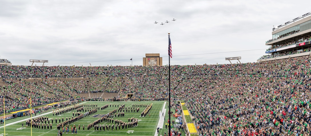 Four T-6 Texan IIs assigned to the 37th Flying Training Squadron fly over Notre Dame Stadium before the game against Ball State Sept. 8, 2018, in South Bend, Indiana. The 37th FTS accomplished 188 sorties from Sept. 6-10, and also increased knowledge and proficiency for all instructor pilots in an off-station training environment in addition to performing a flyover. (Photo by Matt Cashore/University of Notre Dame)