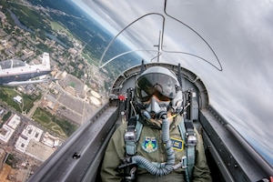 Notre Dame Air Force ROTC cadet Jill Ruane passes over campus as a backseater in a formation of two T-6 Texan IIs Sept. 9, 2018, in South Bend, Indiana. Several cadets from the Notre Dame Air Force ROTC program took familiarization flights in the T-6 the Sunday following the football game against Ball State. The aircraft belong to the 37th Flying Training Squadron who were on campus to perform the pregame flyover at the football game the previous day. (Photo by Matt Cashore/University of Notre Dame)