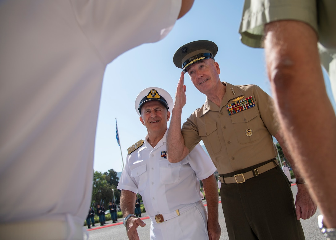 Marine Corps Gen. Joe Dunford, chairman of the Joint Chiefs of Staff, greets the staff of Greek Navy Adm. Evangelos Apostolakis, chief of the Hellenic National Defense General Staff, at the Ministry of Defense in Athens, Greece.
