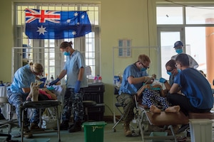 United States and Australian service members perform dental exams, cleanings and teeth extractions as part of Pacific Angel (PAC ANGEL) 18-2 at the Cultural House of Tam Giang commune in Nui Thanh, Quang Nam province, Vietnam, Sept. 12, 2018.