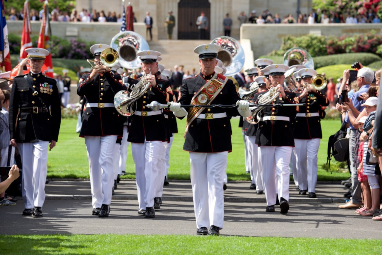 A Marine band marches at an event.