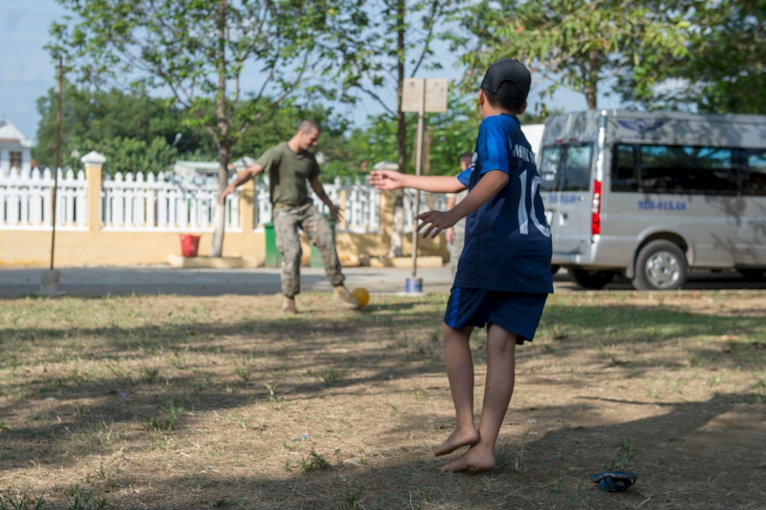 U.S. Marine Corps Cpl. David Ricketts, 7th Engineer Support Battalion combat engineer,  plays soccer with Tien Tho Primary School students during Pacific Angel (PAC ANGEL) 18-2 in Tien Tho commune, Tien Phuoc district, Vietnam, Sept. 10, 2018.
