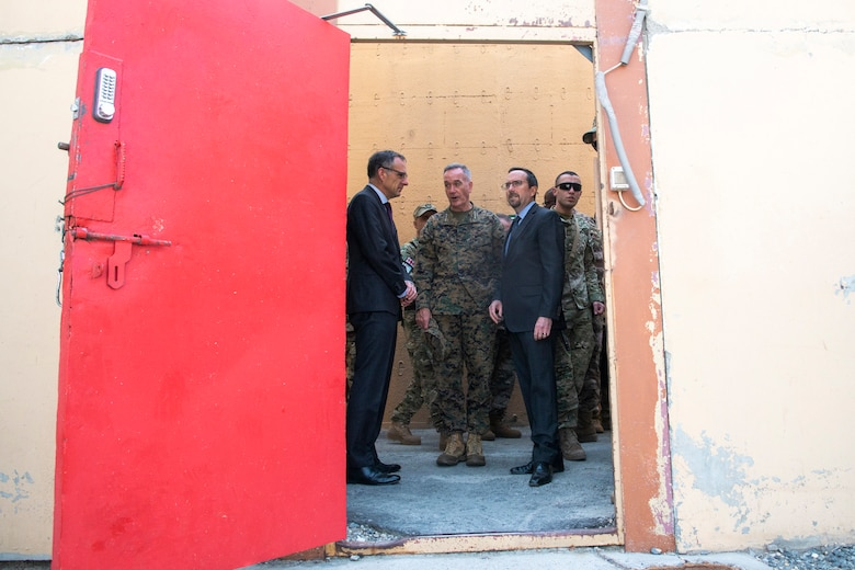 Marine Corps Gen. Joe Dunford, chairman of the Joint Chiefs of Staff, and U.S. Ambassador to Afghanistan John Bass await the arrival of Defense Secretary James N. Mattis at Resolute Support Headquarters in Kabul, Afghanistan.