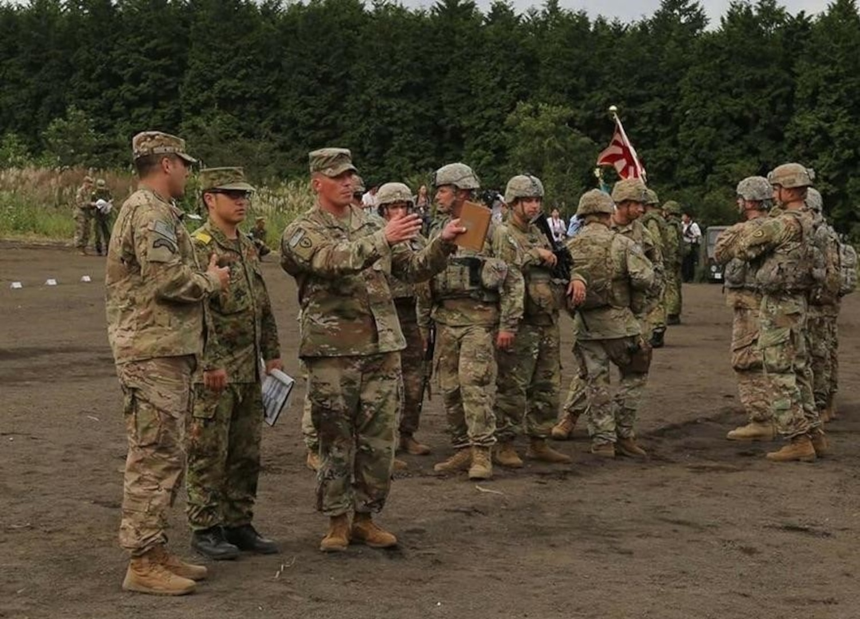 Transportation Operator Uses Language Skills Between Two Militaries