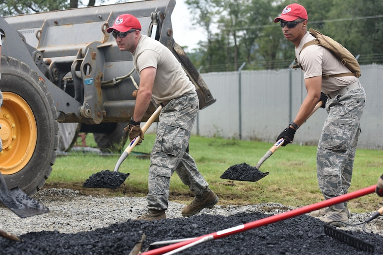 Airmen with the 201st RED HORSE Squadron, Fort Indiantown Gap, Pennsylvania, spread asphalt in preparation for paving a small section on base Sept. 7, 2018. The second day of the field training exercise was focused on specific career field training for eight different Air Force Specialty Codes. (U.S. Air National Guard photo by Senior Airman Julia Sorber/Released)