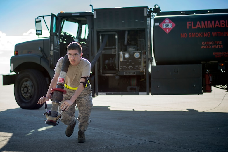 A 6th Logistics Readiness Squadron Airman tows a fuel hose during an operational readiness exercise at MacDill Air Force Base, Florida, Sept. 12, 2018