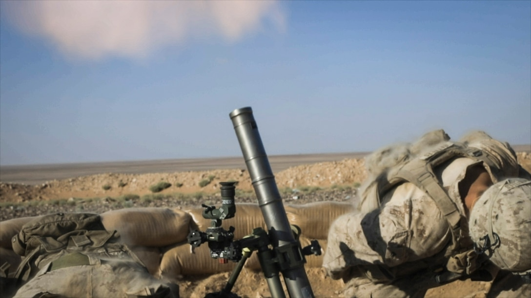 SOUTHWEST ASIA – U.S. Marines with 3rd Battalion, 7th Marine Regiment, attached to Special Purpose Marine Air-Ground Task Force, Crisis Response-Central Command fire an M224 60 mm mortar system during a live-fire demonstration near At-Tanf Garrison, Syria, Sept. 7, 2018. SPMAGTF-CR-CC Marines supported Special Operations Joint Task Force – Operation Inherent Resolve, conducting live-fire demonstrations showcasing the unit's crisis response capabilities. (U.S. Marine Corps photo by Cpl. Carlos Lopez)