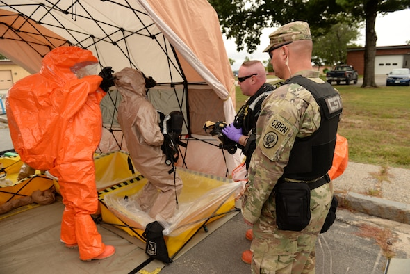 Sgt. Jeffery Garand, and Staff Sgt. David Turner, New Hampshire National Guard 12th Civil Support Team, observe the decontamination of Sgt. David Fostier, center, as part of an external evaluation of the 12th CST's overall mission readiness, Sept. 11, 2018, at Pease Air National Guard Base, N.H. The 12th CST includes 22 N.H. National Guard airmen and soldiers who are ready to mobilize within one hour. The team is designed to detect weapons of mass destruction, specializing in the detection of chemical, nuclear, biological and explosive agents. (Photo by Master Sgt. Thomas Johnson, 157th ARW Public Affairs)