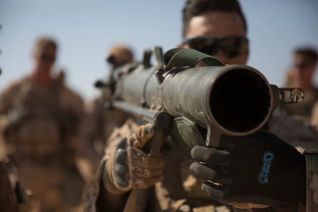 SOUTHWEST ASIA  –U.S. Marine Corps Lance Cpl. Jorge Castrosamaniego, an assault man with 3rd Battalion, 7th Marine Regiment, attached to Special Purpose Marine Air-Ground Task Force, Crisis Response-Central Command, learns how to utilize an 84 mm Carl Gustaf recoilless rifle near At-Tanf Garrison, Syria Sept. 9, 2018. SPMAGTF-CR-CC Marines supported Special Operations Joint Task Force – Operation Inherent Resolve, conducting live fire demonstrations showcasing the unit's crisis response capabilities.  (U.S. Marine Corps photo by Cpl. Roderick Jacquote)