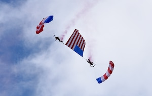 The Patriot Parachute Team performs a skydiving routine at the Frontiers in Flight Open House and Air Show Sept. 9, 2018, at McConnell Air Force Base, Kansas. The team is comprised of five veterans, who learned parachuting from their combat experiences. (U.S. Air Force photo by Airman 1st Class Michaela R. Slanchik)