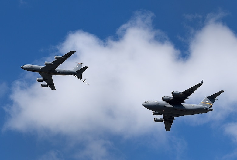 A KC-135 Stratotanker and a C-17 Globemaster III perform an aerial refueling demonstration at the Frontiers in Flight Open House and Air Show Sept. 9, 2018, at McConnell Air Force Base, Kansas. The KC-135 is capable of refueling aircraft in flight, enabling global reach. (U.S. Air Force photo by Airman 1st Class Michaela R. Slanchik)