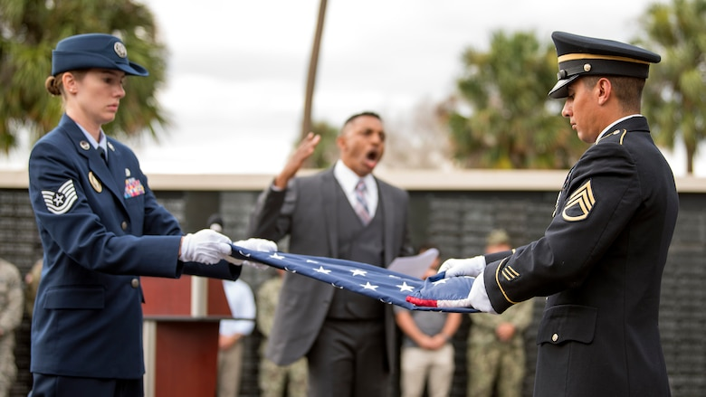 Service members from MacDill Air Force Base, Fla., complete a two-man flag fold during a 9/11 memorial ceremony Sept. 11, 2018. The remembrance ceremony was held at the U.S. Special Operations Command Memorial in honor of those who died during the attacks.