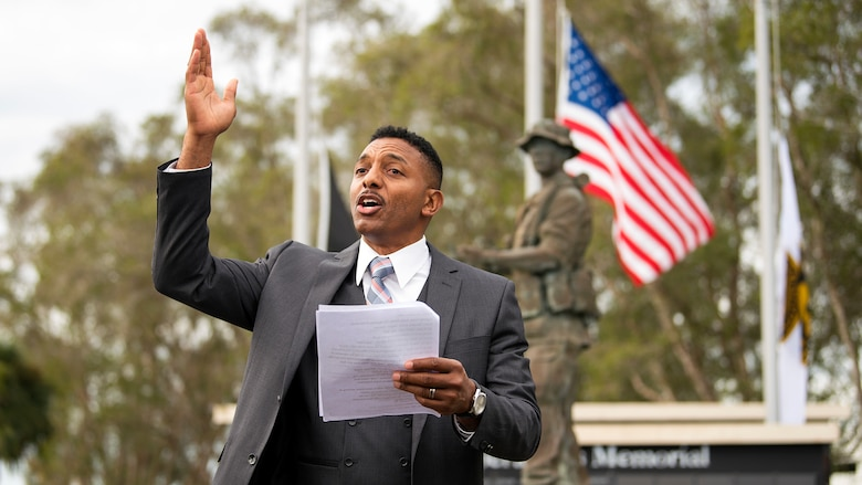 "A Team MacDill Member performs ""Old Glory"" during a 9/11 memorial ceremony held at MacDill Air Force Base, Fla., Sept. 11, 2018. The remembrance ceremony was held at the U.S. Special Operations Command Memorial in honor of those who died during the attacks."