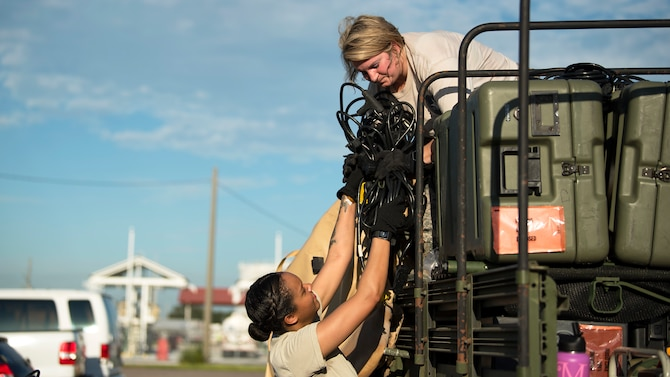 Members from the En-Route Patient Staging System team from MacDill Air Force Base, Fla., load equipment onto a Humvee Sept. 13, 2018, in preparation of Hurricane Florence. The ERPSS team's mission is to provide clinical support to patients in response to a natural disaster.
