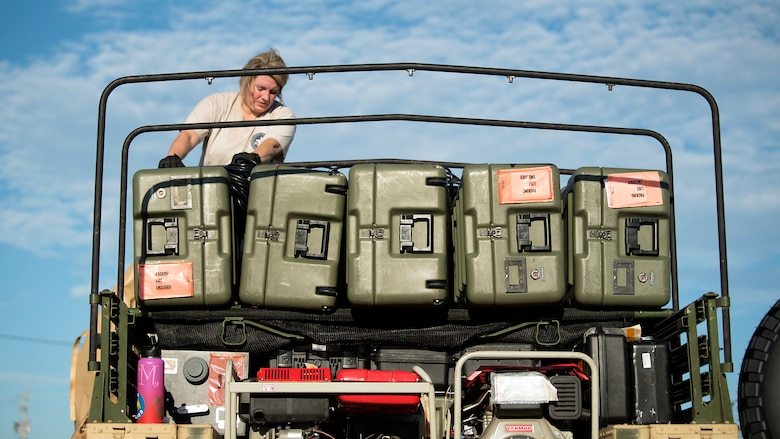 An En-Route Patient Staging System team member finishes loading equipment onto a Humvee Sept. 13, 2018, in preparation of Hurricane Florence. The ERPSS team's mission is to provide clinical support to patients in response to a natural disaster.  (U.S. Air Force photo by Airman 1st Class Caleb Nunez)