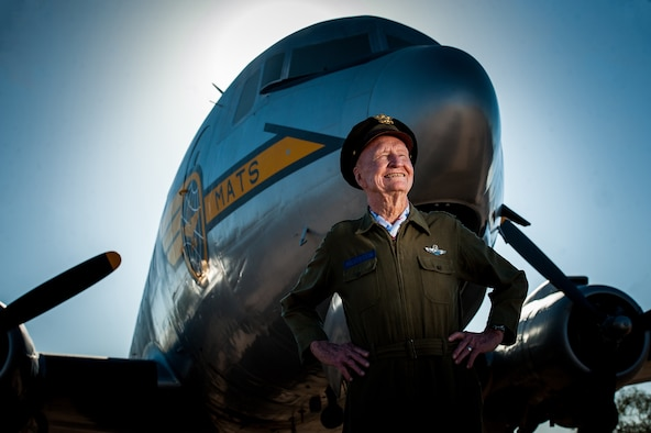 "Retired Col. Gail S. Halvorsen, known commonly as the Berlin ""Candy Bomber,"" stands in front of a C-54 Skymaster like the one he flew during WWII at the Pima Air and Space Museum in Arizona. Halvorsen dropped candy bars attached to parachutes made from handkerchiefs to German children watching the airlift operations from outside the fence of the Tempelhof Airport in West Berlin. (U.S. Air Force photo/Bennie J. Davis III)"