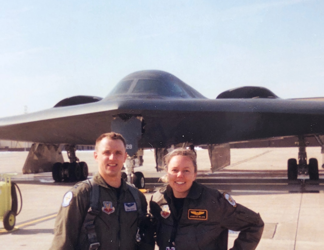 U.S. Air Force Capts. John and Jennifer Avery smile for a photo in front of the B-2 Spirit at an Whiteman Air Force Base, Missouri. The Averys were the first husband-wife team to fly the B-2. The couple served with the 509th Bomb Wing at Whiteman AFB and then with the base's Missouri National Guard 131st Bomb Wing. Their shared military careers culminated at their joint retirement ceremony Sept. 7, 2018, at Whiteman AFB. The couple has two children, Austin and Elizabeth, and live in Boise, Idaho. (Photo courtesy of the Avery family)