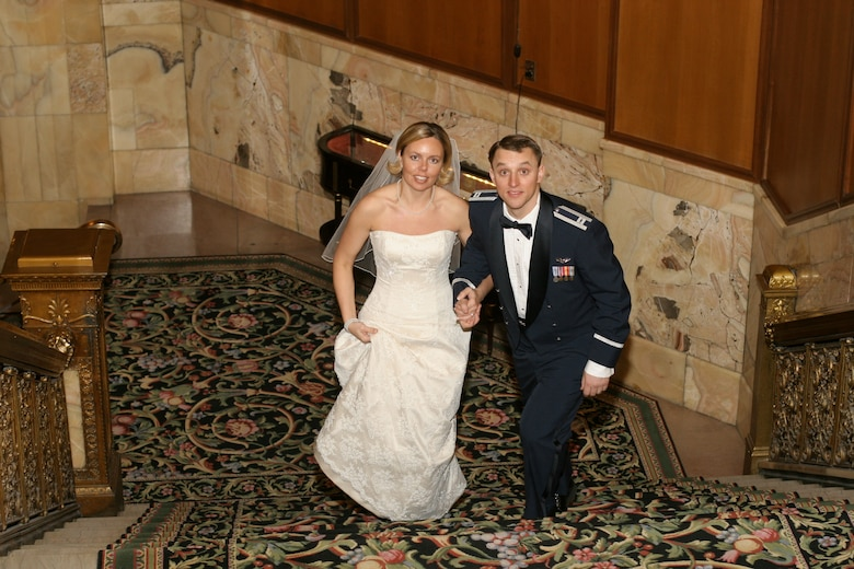U.S. Air Force B-2 Spirit pilots John and Jennifer Avery smile for a photo on their wedding day Feb. 5, 2005. Their shared military careers culminated at their joint retirement ceremony Sept. 7, 2018, at Whiteman Air Force Base, Missouri. The couple has two children, Austin and Elizabeth, and live in Boise, Idaho. (Photo courtesy of the Avery family)