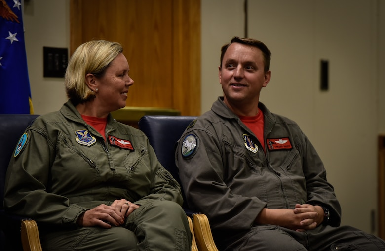 (From left) Lt. Cols. Jennifer and John Avery sit together during their retirement ceremony Sept. 7, 2018 at Whiteman Air Force Base, Missouri. The Averys were the first husband-wife team to fly the B-2. The couple served with the 509th Bomb Wing at Whiteman Air Force Base and then with the base's Missouri National Guard 131st Bomb Wing. (U.S. Air Force photo by Tech. Sgt. Alexander W. Riedel)