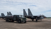Airmen from the 2nd Logistic Readiness Squadron petroleum, oils and lubricants distribution flight prepare to fuel F-15E Strike Eagles from Seymour Johnson Air Force Base, North Carolina at Barksdale Air Force Base, La., Sept. 12, 2018. The aircraft evacuated to Barksdale to avoid possible damage from Hurricane Florence