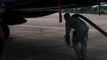 An Airman from the 2nd Logistic Readiness Squadron petroleum, oils and lubricants distribution flight prepare to fuel F-15E Strike Eagles from Seymour Johnson Air Force Base, North Carolina at Barksdale Air Force Base, La., Sept. 12, 2018. The aircraft evacuated to Barksdale to avoid possible damage from Hurricane Florence.