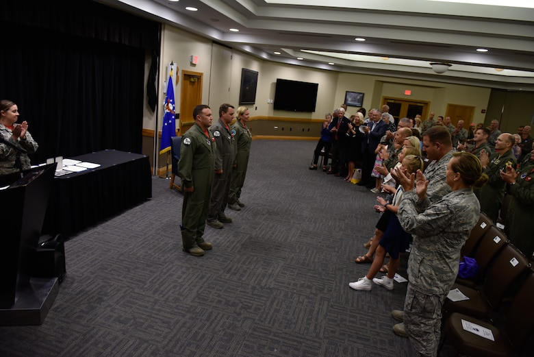 "From left, U.S. Air Force Col. Jared Kennish stands next to Lt. Cols. John and Jennifer Avery during their joint retirement from the Missouri Air National Guard, Sept 7, 2018, at Whiteman Air Force Base, Missouri. The Averys married on Feb. 5, 2005, becoming the first husband and wife team to fly the B-2 Stealth bomber. At their official retirement September ceremony at Whiteman AFB, standing in front of their families and closest friends, John and Jennifer were presented medals for outstanding military service and certificates of appreciations from the president of the United States before the reading of the orders declaring they were ""relieved from duty and retired."" (U.S. Air Force photo by Tech. Sgt. Alexander W. Riedel)"