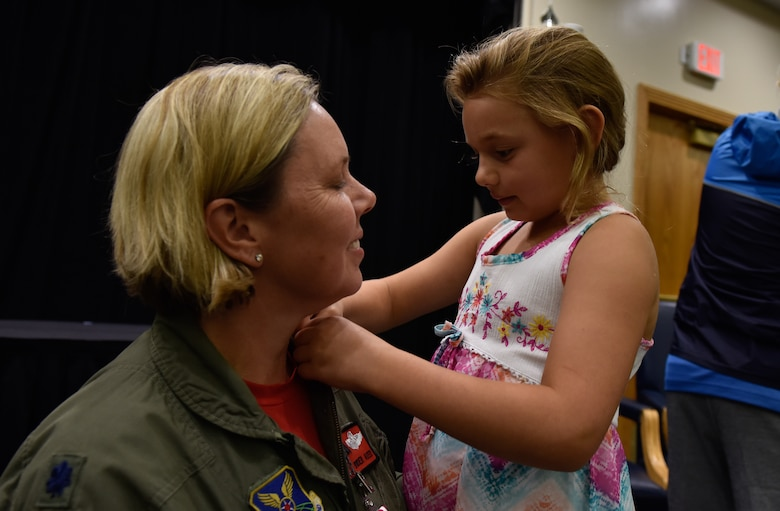 U.S. Air Force Lt. Col. Jennifer Avery receives her retirement pin from her daughter Elizabeth during a retirement ceremony Sept. 7, 2018, at Whiteman Air Force Base, Missouri. Avery was the first female to the fly the B-2 Spirit. She is the first and only female to fly stealth bomber in combat, and was also the first female to fly the B-1 in combat. She retired from the Air National Guard's 131st Bomb Wing.(U.S. Air Force photo by Tech. Sgt. Alexander W. Riedel)
