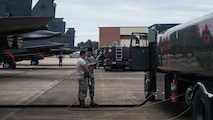 Airmen from the 2nd Logistic Readiness Squadron petroleum, oils and lubricants distribution flight prepare to fuel F-15E Strike Eagles from Seymour Johnson Air Force Base, North Carolina at Barksdale Air Force Base, La., Sept. 12, 2018. The aircraft evacuated to Barksdale to avoid possible damage from Hurricane Florence.