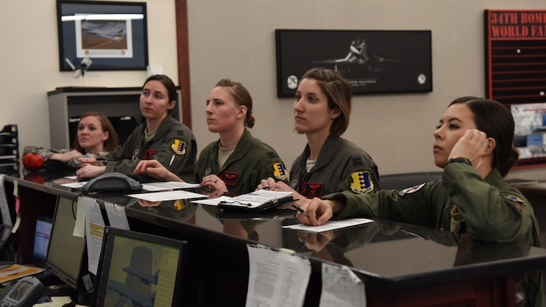 Capt. Lacey Koelling, 34th Aircraft Maintenance Unit officer in charge, and 34th Bomb Squadron members Capt. Lillian Pryor, a B-1 pilot; Capt. Danielle Zidack, a weapon systems officer; Capt. Lauren Olme, a B-1 pilot; and 1st Lt. Kimberly Auton, a weapon systems officer, conduct a preflight briefing prior to an all-female flight out of Ellsworth Air Force Base, S.D., March 21, 2018. The flight was in honor of Women�s History Month and consisted of routine training in the local area. (U.S. Air Force photo by Staff Sgt. Jette Carr)