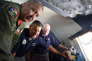 U.S. Air Force Tech. Sgt. Robert Reyes, 433rd Aircraft Maintenance Squadron aircraft engine mechanic, shows controls on a C-5M Super Galaxy aircraft to Civil Air Patrol senior members at Joint Base San Antonio-Lackland, Texas, Sept. 8, 2018