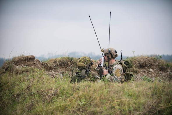 A United States Air Force joint terminal attack controller (JTAC) and a Czech Republic Air Force JTAC call in Close Air Support (CAS) during Ample Strike 2018. Ample Strike is a Czech Republic-led live exercise that offers JTACs and close air support aircrews advanced air/land integration training in day and night operations. This is the fourth iteration of exercise Ample Strike. (U.S. Navy photo by Mass Communication Specialist 2nd Class Robert J. Baldock)