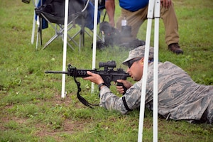 Tech Sgt. Francisco Gonzalez, Air Force Reserve Command Defender Challenge team member, fires an M4 carbine rifle at the Brain in a Box during the combat endurance relay Sept. 13, 2018 at Camp Bullis Military Training Reservation, Texas.