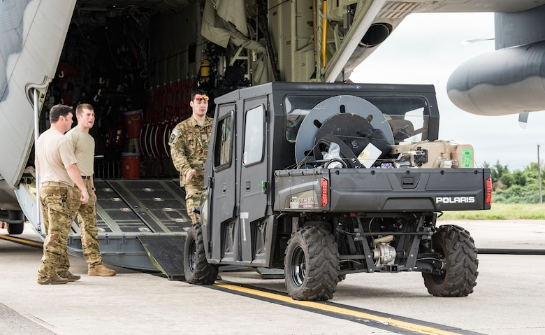 Alaska Air National Guard personnel offload a vehicle from a HC-130J Sept. 13, 2018, at Dover Air Force Base, Del. Members and equipment from the 176th Wing, 176th Aircraft Maintenance Squadron, 211th and 212th Rescue Squadrons at JBER arrived at Dover on Sept. 12 to support hurricane relief efforts when called upon. (U.S. Air Force photo by Roland Balik)