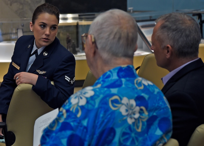 Airman 1st Class Skylar Armstrong, 1st Airlift Squadron flight attendant, talks with other celebration attendees at the Armed Forces Retirement Home in Washington, D.C., Sept. 14, 2018. Joint Base Andrews Airmen joined retirees from the AFRH to celebrate the Air Force's 71st birthday. (U.S. Air Force photo by Senior Airman Abby L. Richardson)