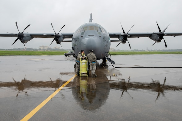 Crew chiefs with the 374th Aircraft Maintenance Squadron stand by as the crew of a C-130J Super Hercules prepare to start their engines prior to a low-cost, low-altitude demonstration at the 2018 Japanese-American Friendship Festival at Yokota Air Base, Japan, Sept. 15, 2018.