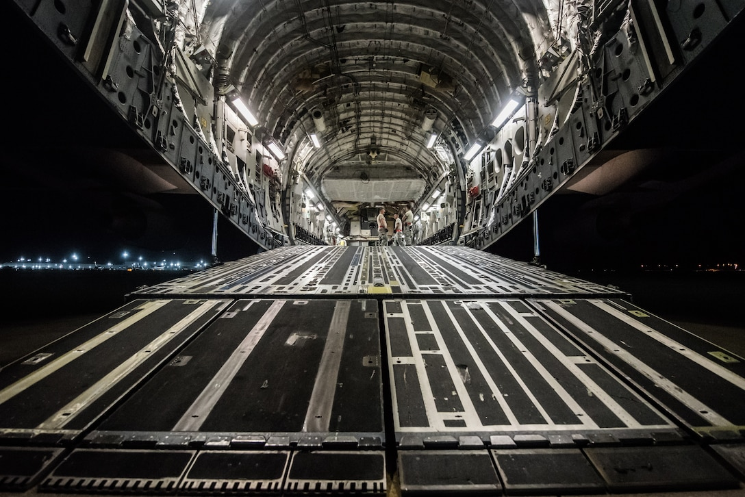 Airmen from the 123rd Airlift Wing load vehicles and cargo onto a C-17 Globemaster III aircraft at the Kentucky Air National Guard Base in Louisville, Ky., Sept. 15, 2018 in response to Tropical Storm Florence. The gear and 10 Airmen from the 123rd Special Tactics Squadron are being deployed to Naval Air Station Oceana in Virginia Beach, Va., to provide stand-alone communications, air traffic control, personnel recovery and paramedic capabilities in response to massive flooding.