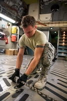 Staff Sgt. Zachary Mohring, an air cargo specialist from the 123rd Airlift Wing, chains down a vehicle while loading a C-17 Globemaster III aircraft at the Kentucky Air National Guard Base in Louisville, Ky., Sept. 15, 2018 in response to Tropical Storm Florence. The vehicle and 10 Airmen from the 123rd Special Tactics Squadron are being deployed to Naval Air Station Oceana in Virginia Beach, Va., to provide stand-alone communications, air traffic control, personnel recovery and paramedic capabilities in response to massive flooding.